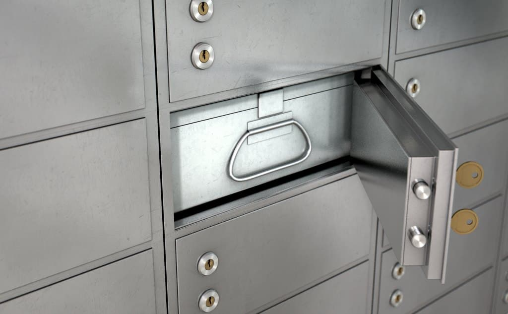A bank lockbox opened so you can see the box inside and the 2 keys that allow entry.